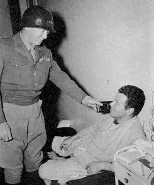 November 22, 1944. Lieutenant General G. S. Patton, Jr., CG Third US Army, visits the 12th Evacuation Hospital to award medals to wounded servicemen.