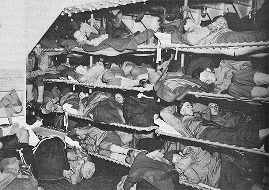Vintage photo illustrating the Enlisted Men's accommodation aboard US military transports during the war. Note the many tiers and the limited space.