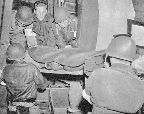 22 May 1943. Air Evacuation out of Tunisia. A litter patient is loaded aboard a converted C-47 cargo plane. The standard chain of evacuation from the battlefields in Tunisia went by road and rail, while air evacuation took the patients directly to fixed Army Hospitals in Algiers and in the vicinity of Oran, both in Algeria. Medical units were often exclusively used as holding units for air evacuation or to serve personnel of an Allied air base. The First and Second Hospitalization Units of the 10th Field Hospital served as a holding unit at Souk-el-Arba, Tunisia, preparing patients for air evac from Tunisia to Algeria (period 16 January 1943 – 23 May 1943).