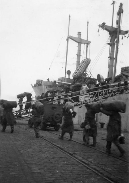 Unidentified American troops board the USAT John Ericsson, the transport that carried the 10th Field Hospital to French Morocco early March 1943.