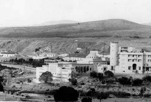Another view of the main building (the Grand Hotel, hot water spring and spa resort) at Sidi Bou Hanifia, Oran area, Algeria, January-February 1943.