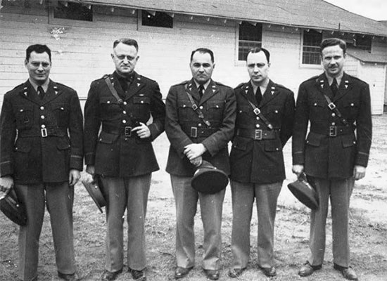 A number of Medical Officers of the 21st General Hospital, while in training at Fort Benning, Georgia, March-September 1942. From L to R: Major Leo Gottlieb, Lieutenant Colonel Lee D. Cady, First Lieutenant Henry P. Lattuada, Major Virgil O. Fish, Major Truman G. Drake, Jr.