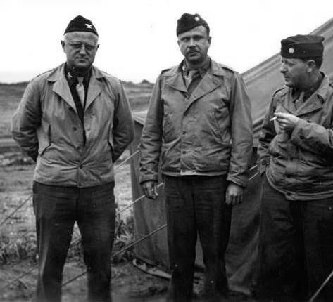 "Three Officers of the 21st General Hospital at the ""infamous"" Goat Hill Staging Area (Oran area, the site of Hassi Ben Okba) , where the organization bivouacked, December 8, 1942. From L to R: Colonel Lee D. Cady, Major Truman G. Drake, Jr., and Major Harry Agress."