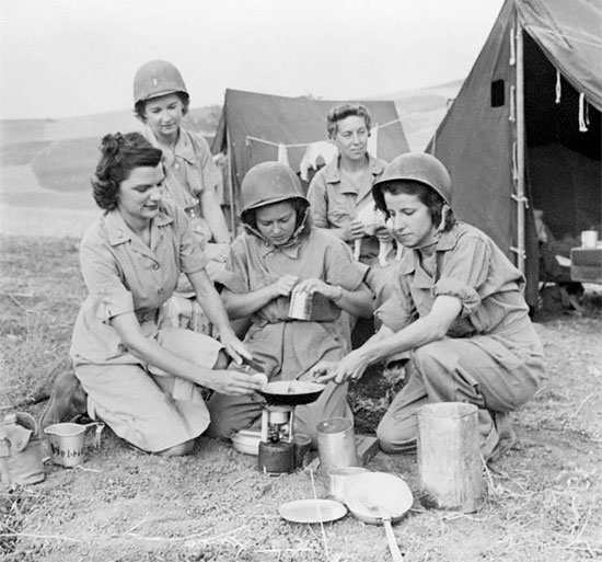 Sicily, 26 July 1943. Photo illustrating some ANC Officers pertaining to the 10th Field Hospital, while indulging in some basic field cooking.