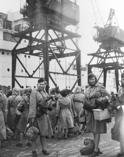 Group of ARC personnel ready to board ship for return to the Zone of Interior, August 19, 1945.