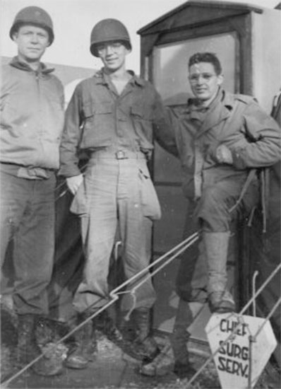 From L to R: Picture illustrating Major Jean M. Stevenson; Sergeant Joe L. Parson; and Private Charles E. Batch, while serving at Lison, France, during summer of 1944.