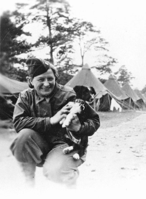 "Portrait of 1st Lieutenant Stella C. Book with ""Fargo"", taken during bivouac at Fargo Plains, a tented camp situated in Wiltshire, England, May-June 1944."