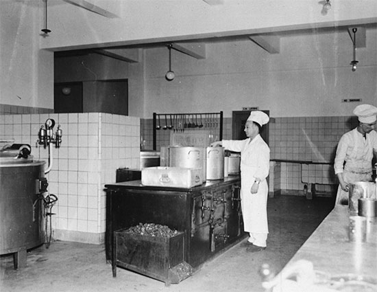 View of the centralized kitchen set up by the 25th General Hospital while stationed at Tongres, Belgium, summer of 1945.