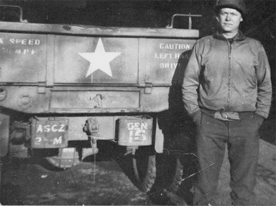Major Jean M. Stevenson, MC, Chief Surgical Service in front of one of the workhorses operated by the 25th General Hospital, the ubiquitous 2 1/2-ton cargo truck (the unit's markings are duly represented: ASCZ 25M GEN 15). Photo taken in December 1944.