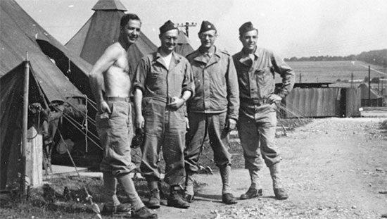 Partial view illustrating some Officers of the 25th General Hospital during their stay near Stockbridge, Hampshire, England, between January and March 1944. Third Officer from left: Major Stanley D. Simon, MC.