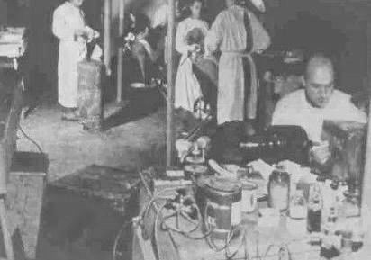 Picture illustrating part of the maxillo-facial clinic (background) and the dental clinic (foreground). The location, a tented hospital, could be Bouc-Bel-Aire, in Southern France.