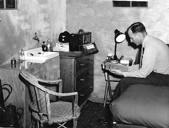 Picture illustrating the Commanding Officer of the 27th Evacuation Hospital in his quarters. Colonel Charles B. Puestow, MC, O-267687, would command the unit from January 1, 1943 to its inactivation December 10, 1945 (with a small interruption). Courtesy UIC