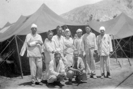 Group of Nurses and patients at Maddaloni, Italy. The 27th Evacuation Hospital operated a tented hospital where they mainly treated French and French colonial troops, between late May and early August 1944.