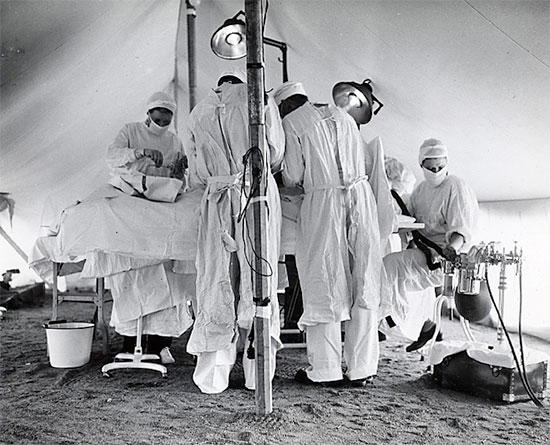 Colonel Charles B. Puestow, Commanding Officer, 27th Evacuation Hospital conducting an operation. It looks like the OR is set up in a tent, but the site is unfortunately not identified. Courtesy UIC.