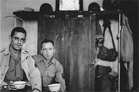 Sgt. James Mooney and S/Sgt. Harry Parker pose for the camera in their barracks