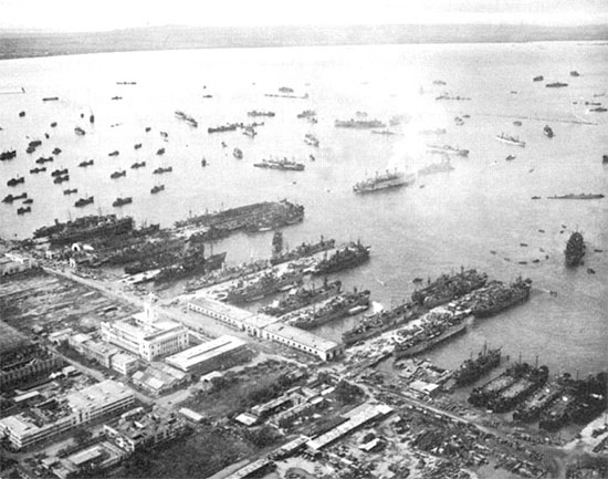 General aerial view of docking facilities and ships at Base X, Manila area, Philippine Islands, 17 September 1945.