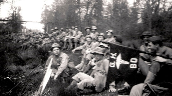 Training in the Zone of Interior. Men take a break during one the hikes (of interest is the Hospital's guidon at right).