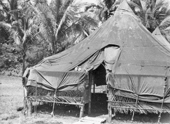 View of an M-1934 Pyramidal Tent set up over a bamboo structure,  as in use with the 80th General Hospital.
