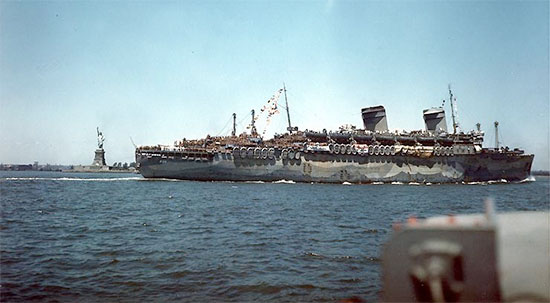 Picture illustrating the USS West Point, AP-23, the troopship which carried the main group of the 189th General Hospital across the Atlantic and to France (this particular picture illustrates the ship on her return to New York with troops from Europe 11 July 1945).