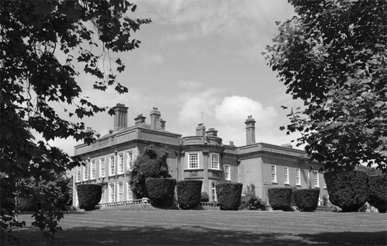 "Partial view of ""Fremington House"" (3 miles west of Barnstaple), Fremington, Devonshire. The 3-story brick construction was used for quarters and messing by the ANC Officers assigned to the 313th Station Hospital."