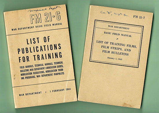 Picture illustrating some of the Field Manuals used during Training by the 313th Station Hospital.
