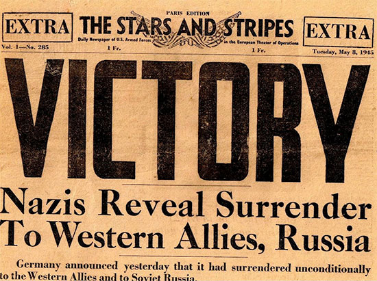 Copy of vintage Stars and Stripes, Paris Edition, dated Tuesday, 8 May 1945, announcing V-E Day.