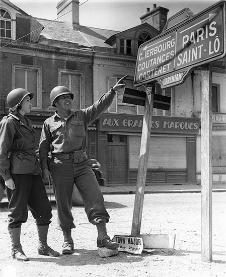 Unidentified Officer and Nurse pictured in Carentan, France.