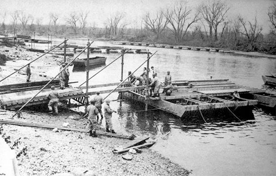 Winter of 1943. Engineers training at Camp Ellis, Fulton County, Illinois. Training activities took place between April 1943 and November 1944. Camp Ellis was a Unit Training Center, as well as a Replacement Pool for Engineer and Medical Officers, and a Prisoner-of-war camp. The installation was declared surplus category October 1, 1945.