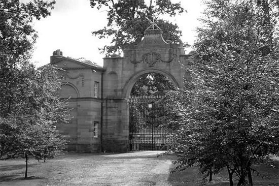 Photograph showing the main gatehouse at Oulton Park, the 50th General Hospital's first home in the United Kingdom.